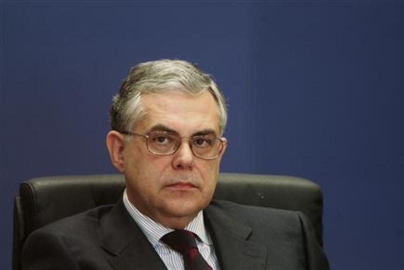 File photo of former deputy head of the European Central Bank Papademos attending a news conference in Athens