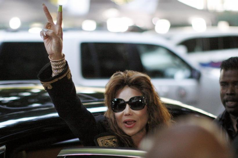 LaToya Jackson waves a victory sign as she leaves the courthouse following a guilty verdict in the Dr. Conrad Murray trial in Los Angeles