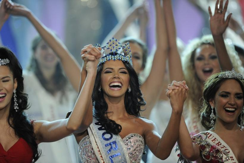 Miss Venezuela, Ivian Sarcos, holds hands with other contestants after being crowned Miss World 2011 in Earls Court in west London