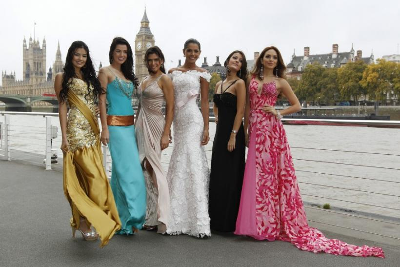 Miss World 2011 contestants pose for photographers in front of the Houses of Parliament and the Big Ben clocktower in London