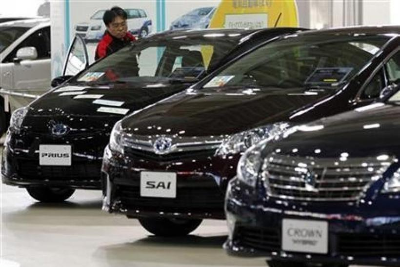 Toyota withdraws outlook on Thai floods, quake, yen