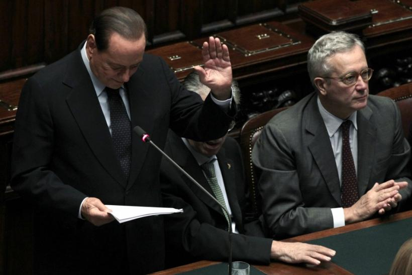 Italy's Prime Minister Silvio Berlusconi gestures as he makes his speech during a debate at the Parliament in Rome