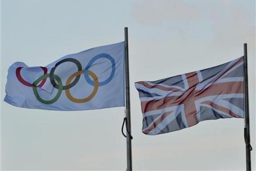 An Olympic flag flies next to the British union flag in central London February 9, 2011.