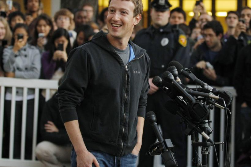 Facebook founder Mark Zuckerberg speaks to a crowd of reporters and students in his first return to Harvard since dropping out in 2004.