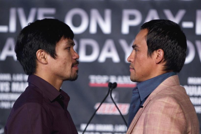 Manny Pacquiao of the Philippines and Juan Manuel Marquez of Mexico pose in New York, during a news conference on their upcoming boxing fight for Pacquiao's WBO welterweight title