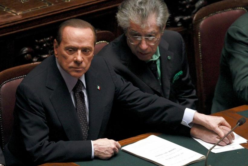 Italian Prime Minister Berlusconi holds League North Party leader Bossi's hand during a finances vote at the parliament in Rome