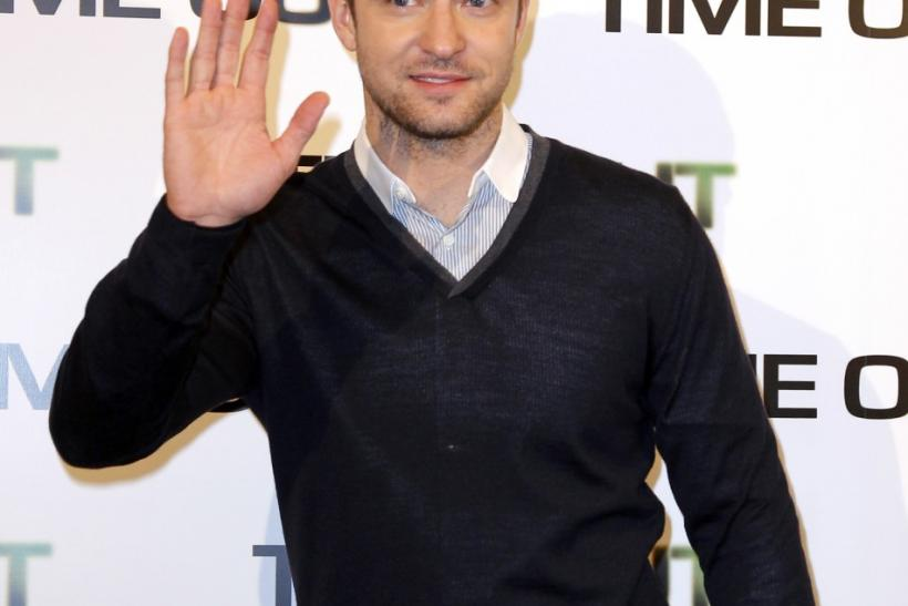 "Cast member Justin Timberlake poses for photographers to promote his latest movie ""In Time"" in Paris"