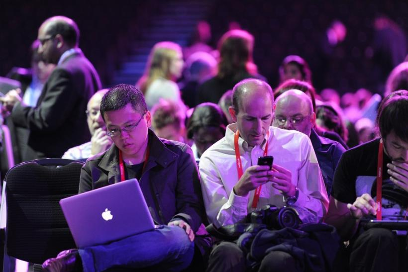 People attending the Nokia World event check their laptops and mobile devices in London