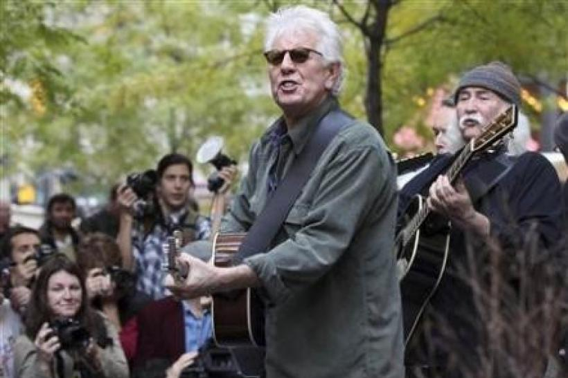Musicians Graham Nash (2nd R) and David Crosby perform in Zuccotti Park where Occupy Wall Street campaign demonstrators have been occupying in New York November 8, 2011.