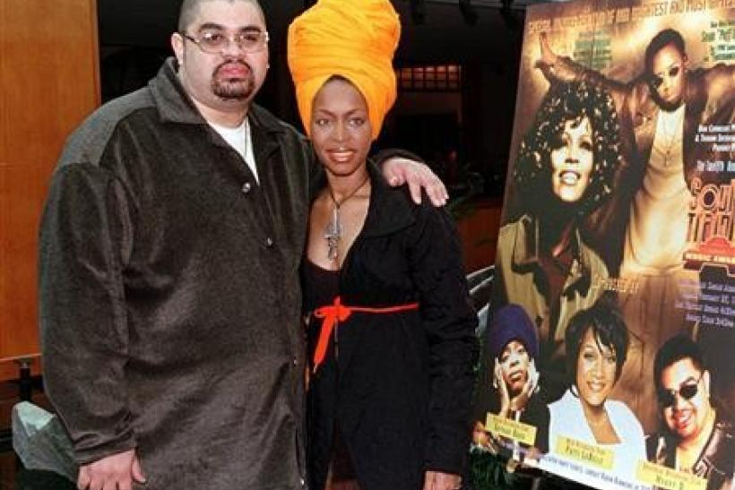 Hip-hop artist Heavy D (L) and singer Erykah Badu