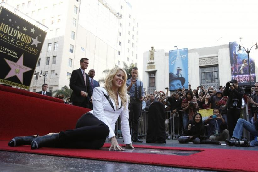 Colombian singer Shakira poses on her star after it was unveiled on the Hollywood Walk of Fame in Hollywood, California