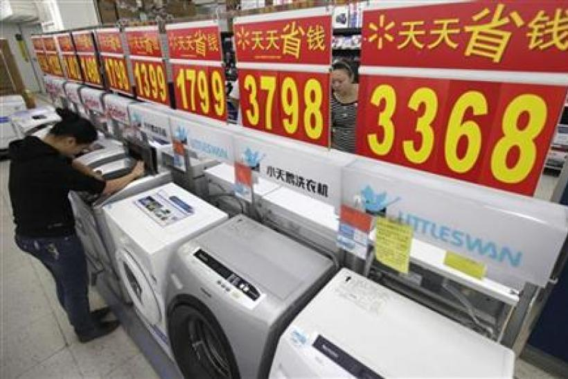 Customers inspect washing machines at a supermarket in Wuhan