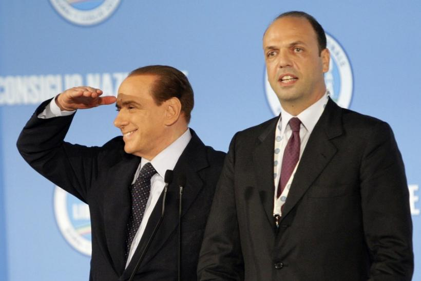 Italy's PM Berlusconi gestures next former justice minister Alfano after Alfano was elected as new party's national political secretary during the PDL party national congress in Rome