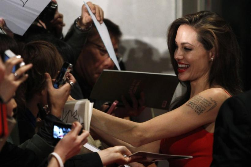 "U.S. actress Angelina Jolie signs autographs for fans during the Japan premiere of the film ""Moneyball"" in Tokyo"