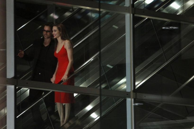 "U.S. actor Brad Pitt and his partner Angelina Jolie arrive at the Japan premiere of Pitt's film ""Moneyball"" in Tokyo"