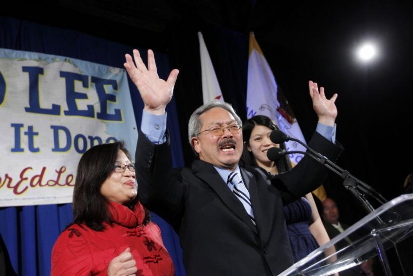 San Francisco Mayor Ed Lee reacts as his wife, Anita, looks on during his election day party in San Francisco