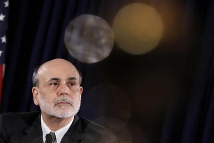 Federal Reserve Chairman Ben Bernanke pauses during a news conference following a two-day policy session in Washington