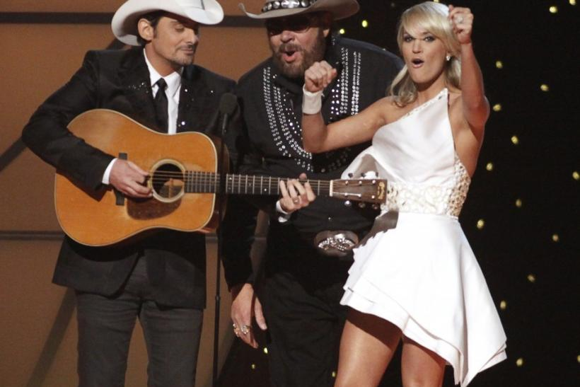 Hank Williams Jr. sings with hosts Brad Paisley and Carrie Underwood at the 45th Country Music Association Awards in Nashville