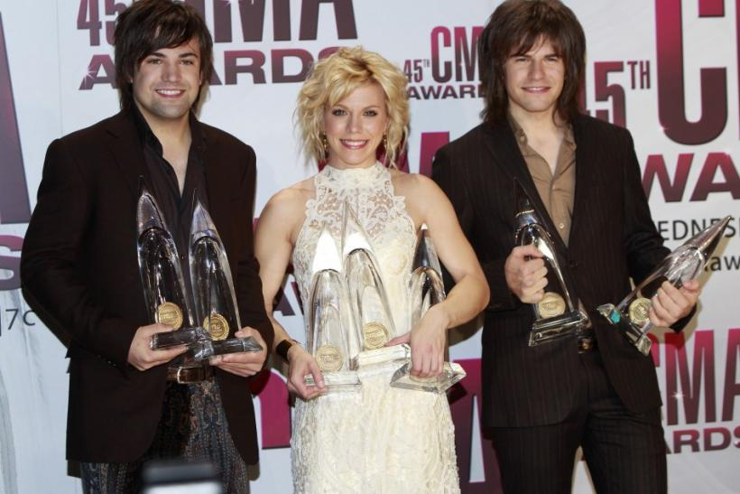 The Band Perry pose with their awards backstage at the 45th Country Music Association Awards in Nashville