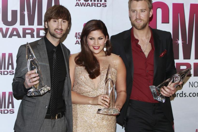 Lady Antebellum pose backstage after winning the Vocal Group of the Year award at the 45th Country Music Association Awards in Nashville