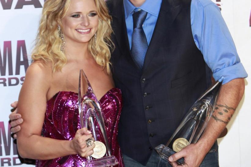 Husband and wife Shelton and Lambert pose with their awards at the 45th Country Music Association Awards in Nashville