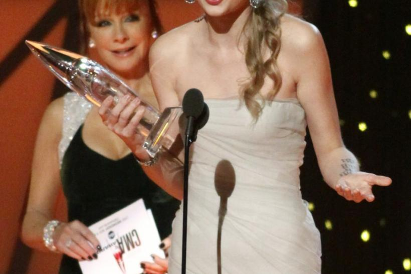Singer Taylor Swift accepts the award for Entertainer of the Year fat the 45th Country Music Association Awards in Nashville