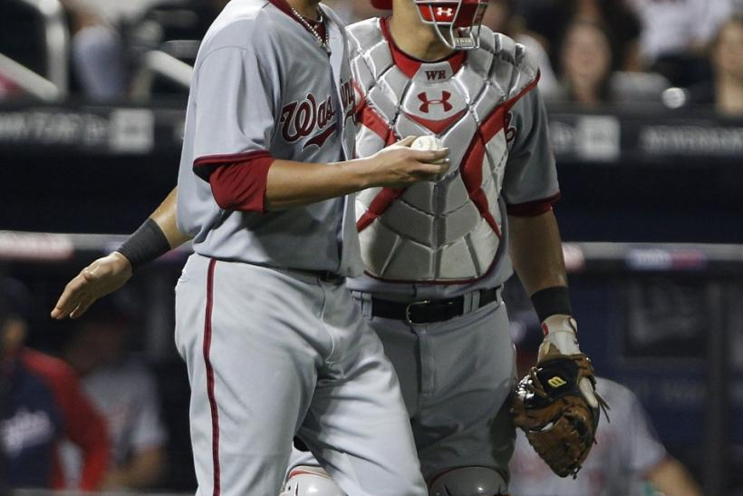Nationals' Ramos chats with Wang on his way back to the mound during MLB National League baseball action against the Mets in New York