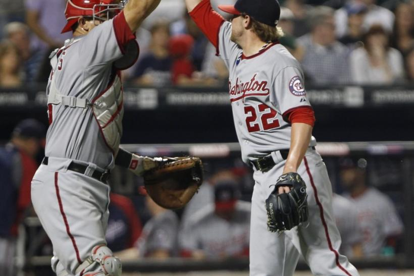 Nationals closing pitcher Storen celebrates with catcher Ramos at the conclusion of their game against Mets in baseball action at Citi Field in New York