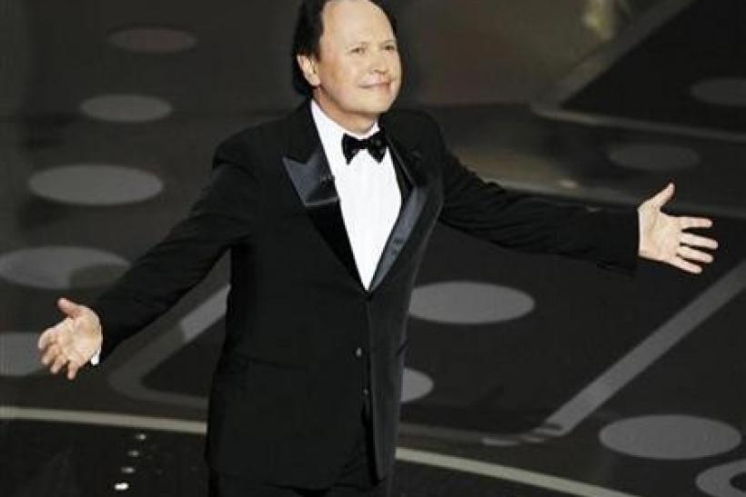 Presenter Billy Crystal stands on stage during the 83rd Academy Awards in Hollywood, California, February 27, 2011.