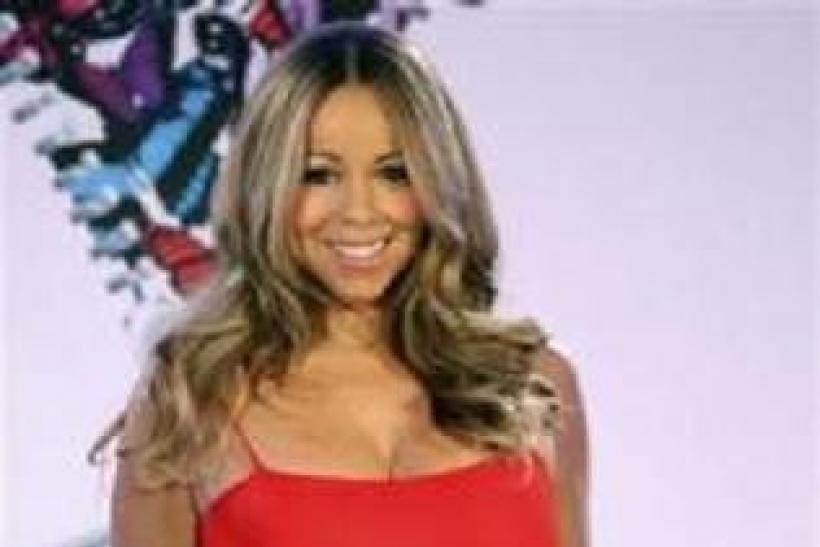 Mariah Carey poses during a press conference announcing that she will be the new brand ambassador for the weight-loss program Jenny, formerly known as Jenny Craig, in New York November 8, 2011.