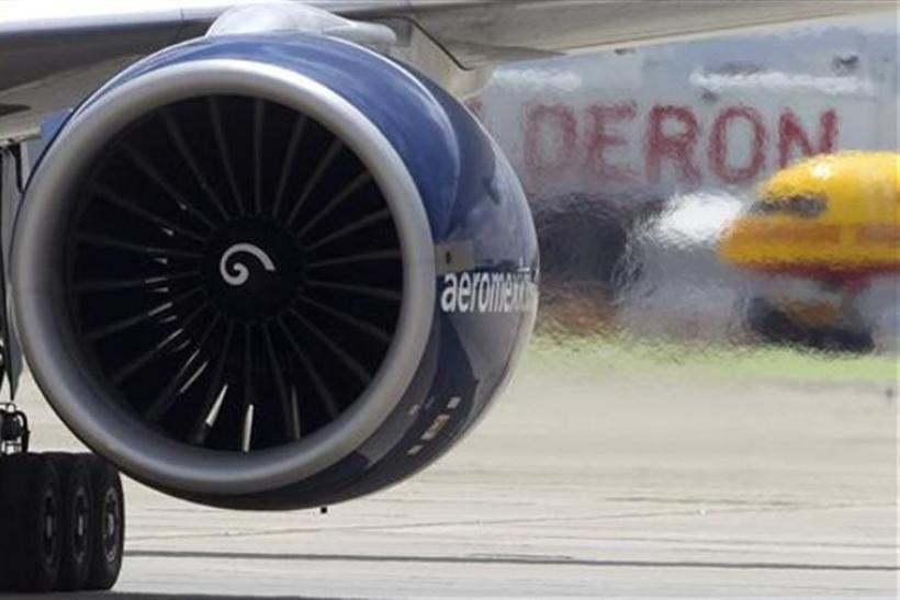 Engine exhaust is seen from an Aeromexico Boeing 777 as it landed marking the first ever commercial transatlantic flight using biofuel in Madrid