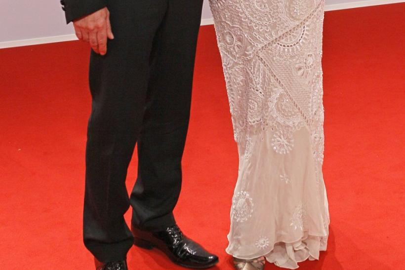 German actors Andrea Sawatzki and Christian Berkel (L) pose on the red carpet as they arrive for the 63rd Bambi media award ceremony in Wiesbaden