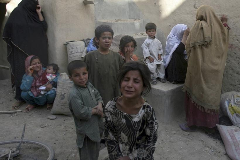 Afghan children are terrified after they hear the blast of a controlled explosion near their house in Ghazni province south of Kabul