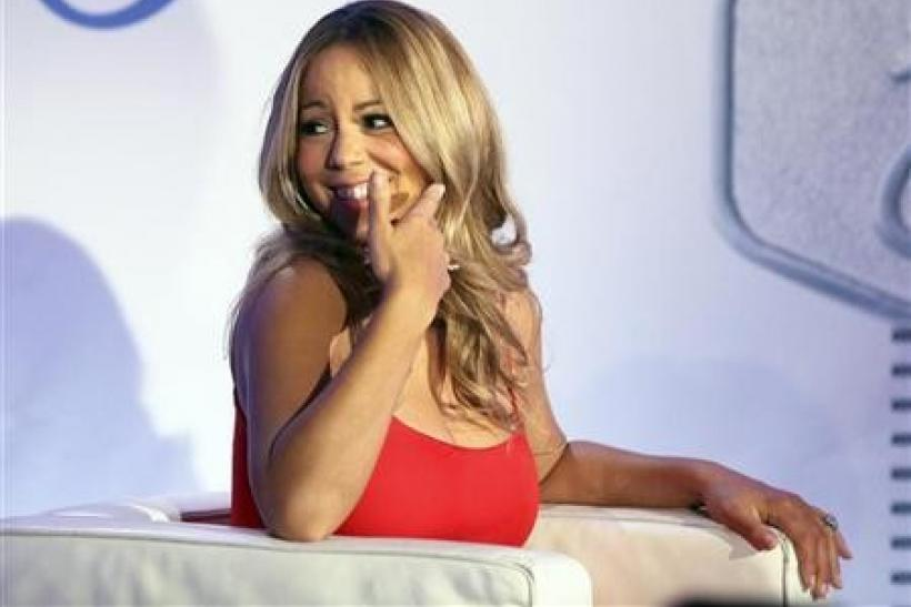 Mariah Carey smiles during a press conference announcing that she will be the new brand ambassador for the weight-loss program Jenny, formerly known as Jenny Craig, in New York