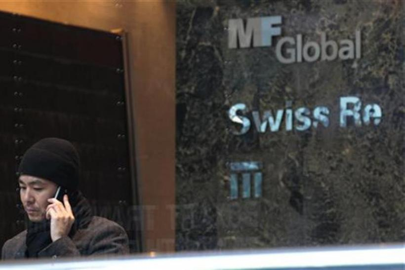 A man talks on the phone inside the office complex where MF Global Holdings Ltd have an office on 52nd Street in midtown Manhattan New York