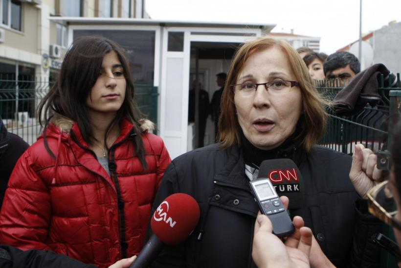 Former hostages Canset Usta and Sude Gundogdu of the hijacked Kartepe ferry speak to media outside a police station in the northwestern Turkish town of Silivri, near Istanbul