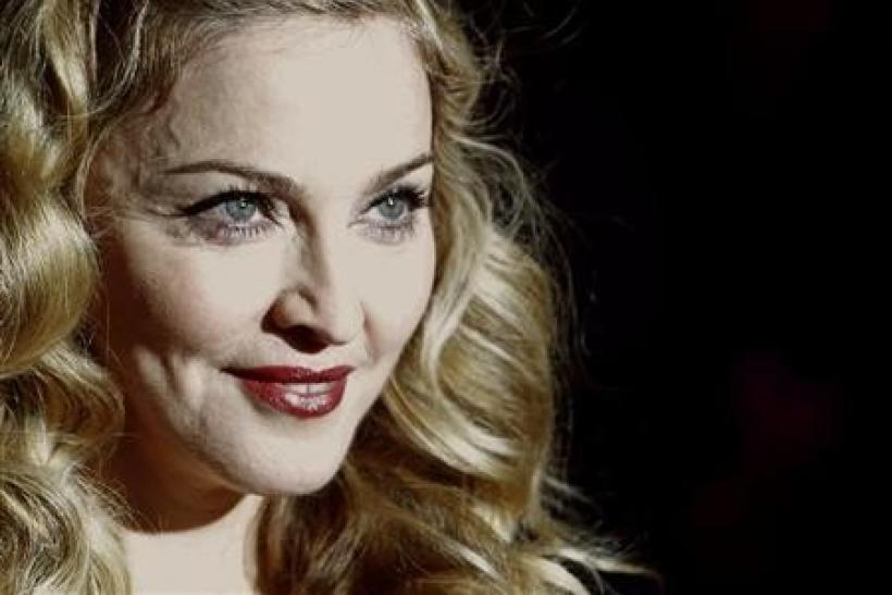 Director Madonna arrives for the gala screening of her film W.E. during the BFI London Film Festival at Leicester Square in London