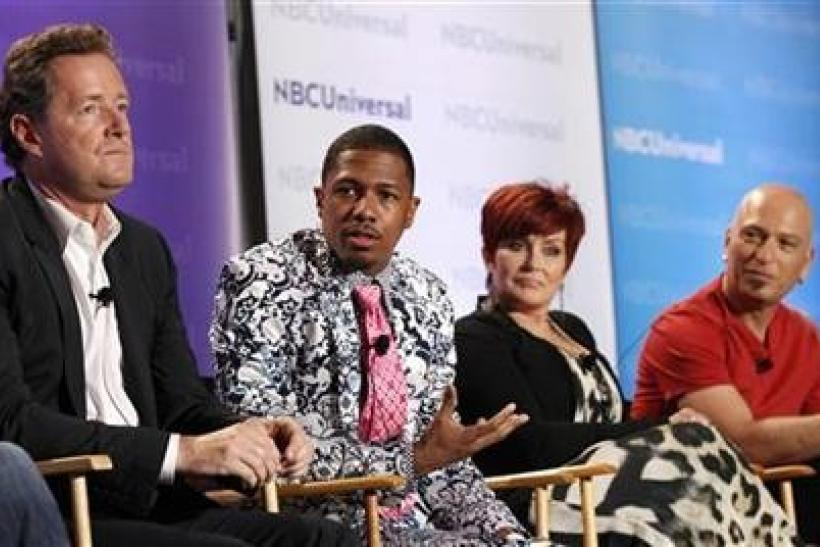Host Nick Cannon (2nd L) and judges Piers Morgan (L), Sharon Osbourne and Howie Mandel attend the NBC panel for the television show ''America's Got Talent'' during the Television Critics Association summer press tour in Pasadena,