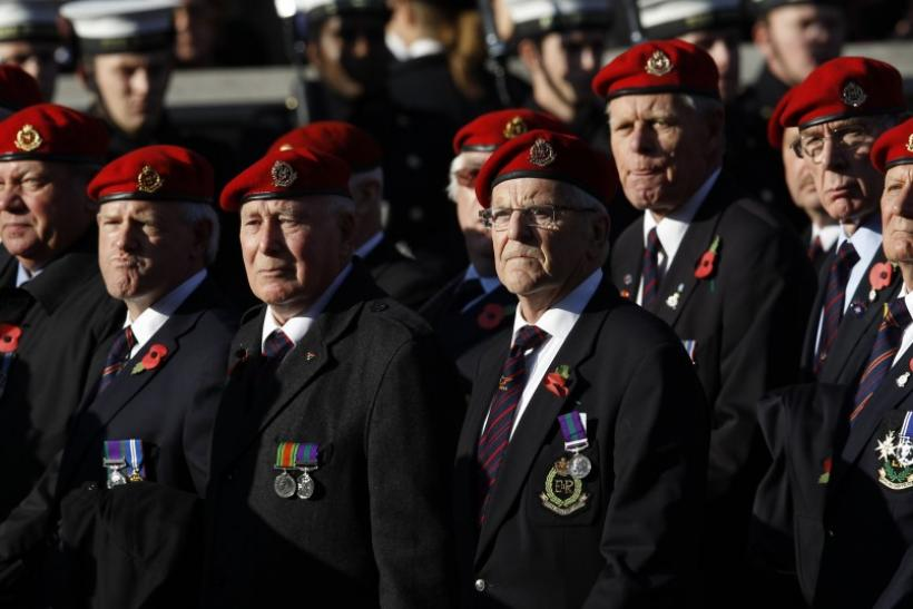 War veterans march past the Cenotaph during the annual Remembrance Sunday ceremony in London November 13, 2011.