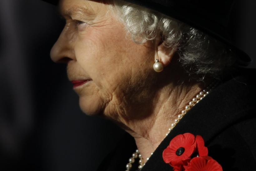 Britain's Queen Elizabeth closes her eyes during the annual Remembrance Sunday ceremony at the Cenotaph in London November 13, 2011.