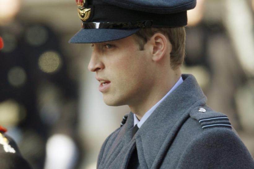 Britain's Prince William sings a hymn during the annual Remembrance Sunday ceremony at the Cenotaph in London November 13, 2011.
