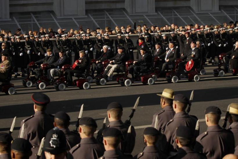 War veterans ride mobility scooters past the Cenotaph during the annual Remembrance Sunday ceremony in London November 13, 2011.