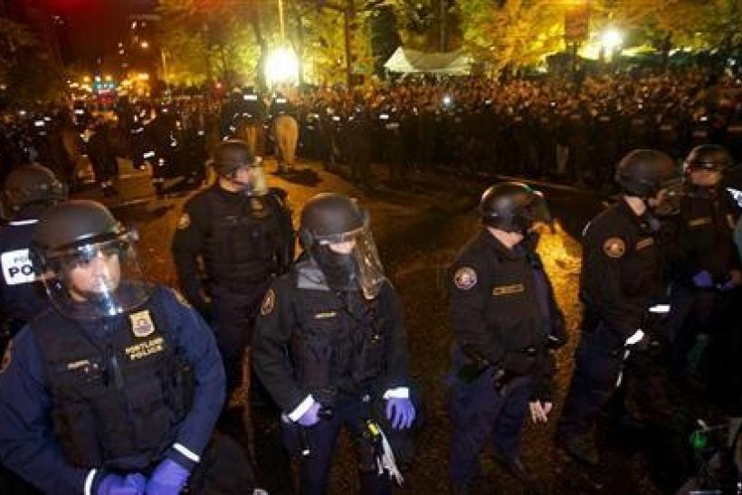 Police clear Occupy Wall Street protesters in Portland, Oregon early November 13, 2011.