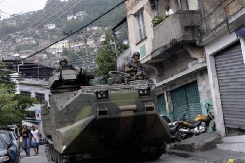 Brazilian Navy soldiers patrol the Vidigal slum
