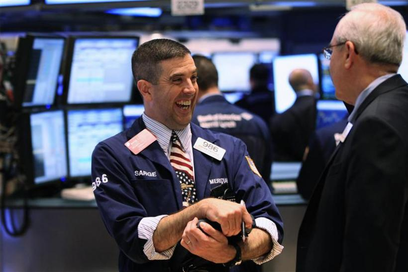 A trader smiles as he works on the floor of the New York Stock Exchange after the closing bell in New York