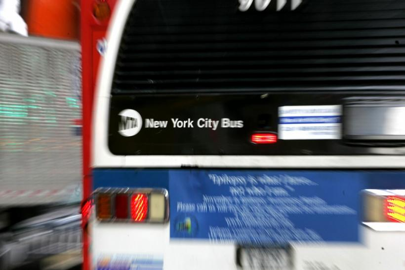 A New York City Metropolitan Transportation Authority (MTA) bus heads west on New York's 42nd Street..