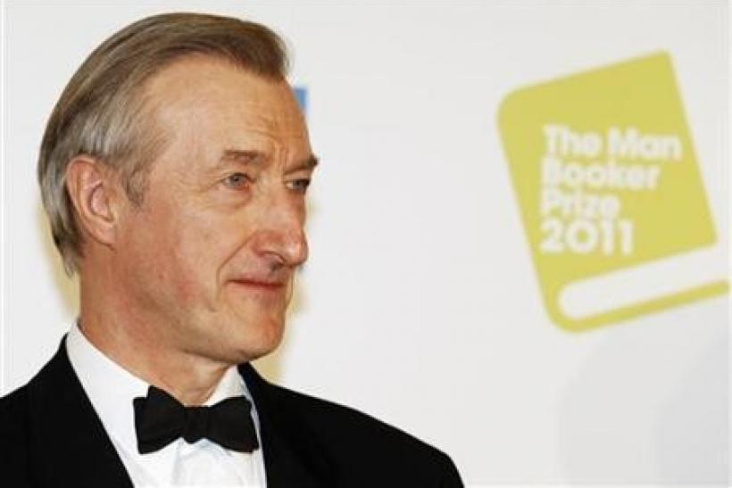 British author Julian Barnes poses after winning the 2011 Man Booker Prize for Fiction with his book' The Sense of an Ending' at the Guildhall in London October 18, 2011.