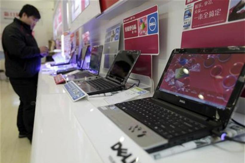 A customer looks at laptops at a Dell outlet in Beijing