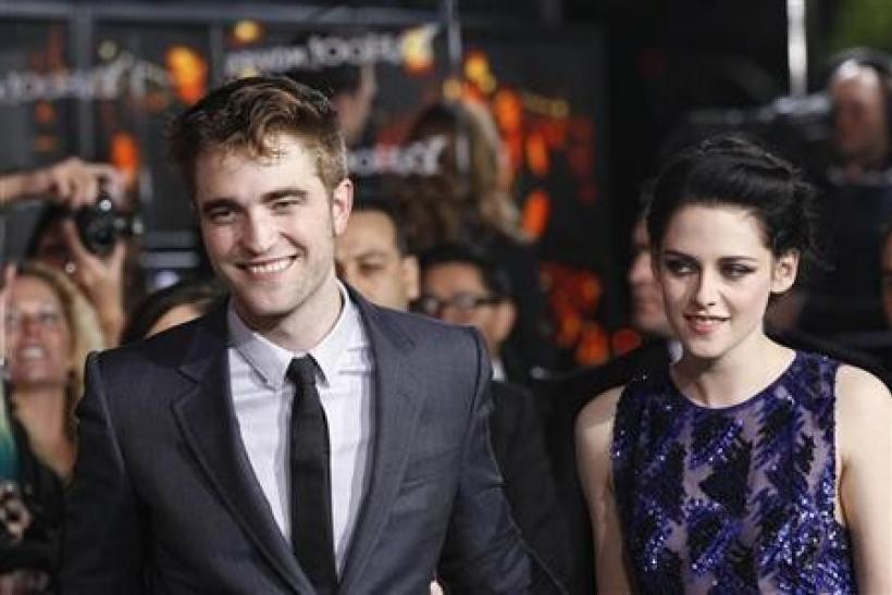 Cast members Robert Pattinson and Kristen Stewart attend the premiere of ''The Twilight Saga: Breaking Dawn - Part 1'' at Nokia Theatre in Los Angeles