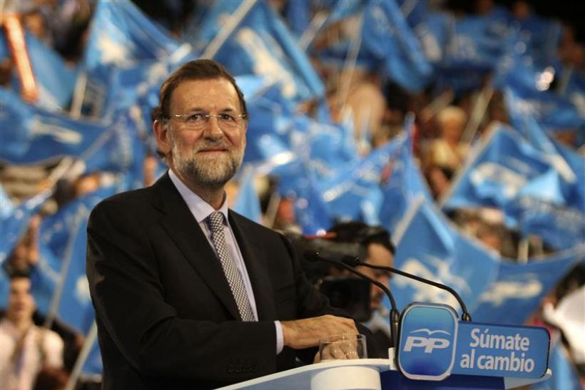Spain's centre-right People's Party (Partido Popular) leader Rajoy gestures as he delivers his speech during a campaign rally in Vigo